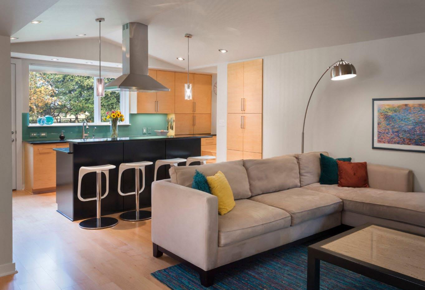 Зонирование кухни-гостиной диваном