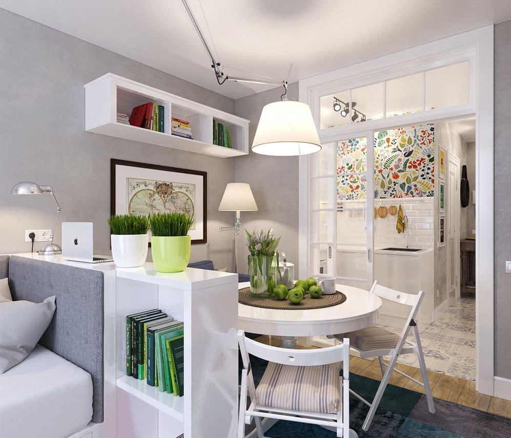 люстра над обеденной зоной в кухне-спальне