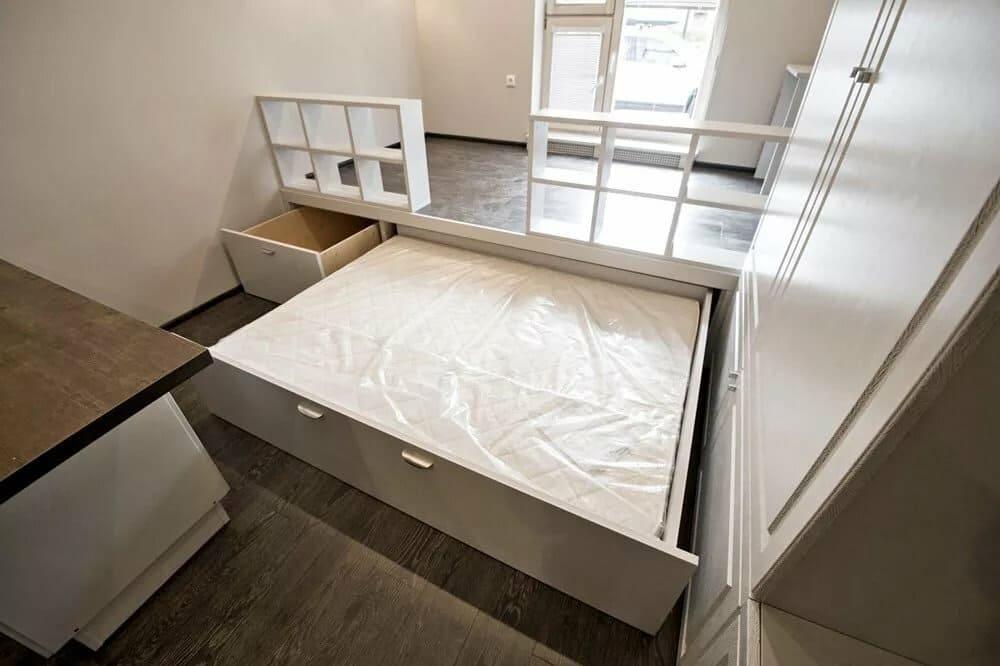 выдвижная кровать в спальне совмещенной с кухней
