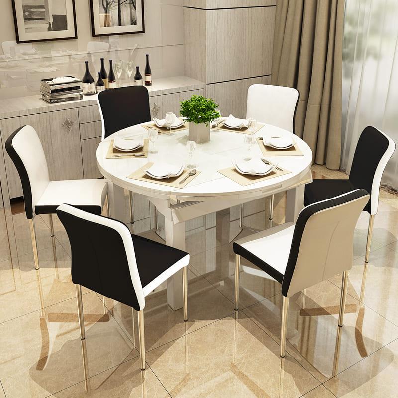 круглый обеденный стол в кухне-гостиной