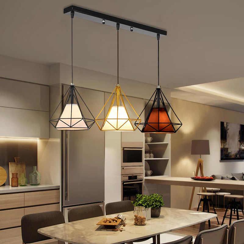 лампы на жестком тросе над столом